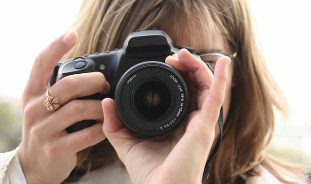 Girl-Taking-Photograph-With-Camera