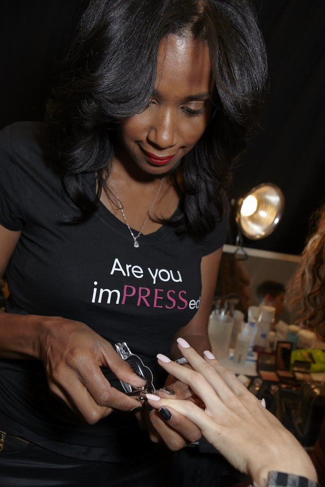 Gina applying nails1 What Trends To Expect Next Year, According To NYFW