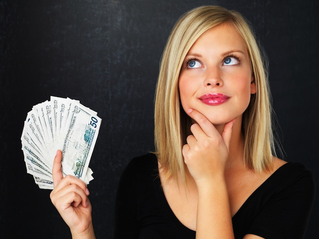 woman holding money book cover What is Success and How Do You Achieve It?