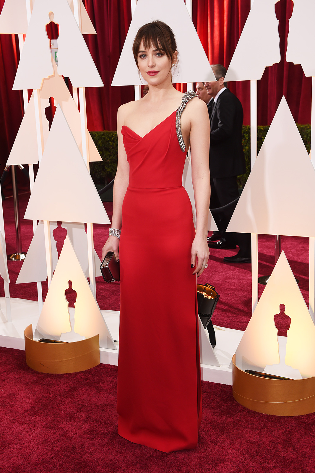 Dakota Johnson at the 2015 Oscars. Learn how to get her look for less on www.brokeandchic.com