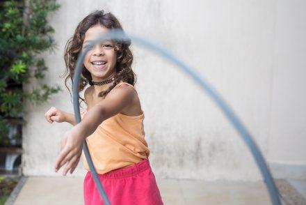 playing with hula hoop
