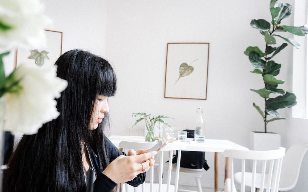 Asian woman using her iPhone