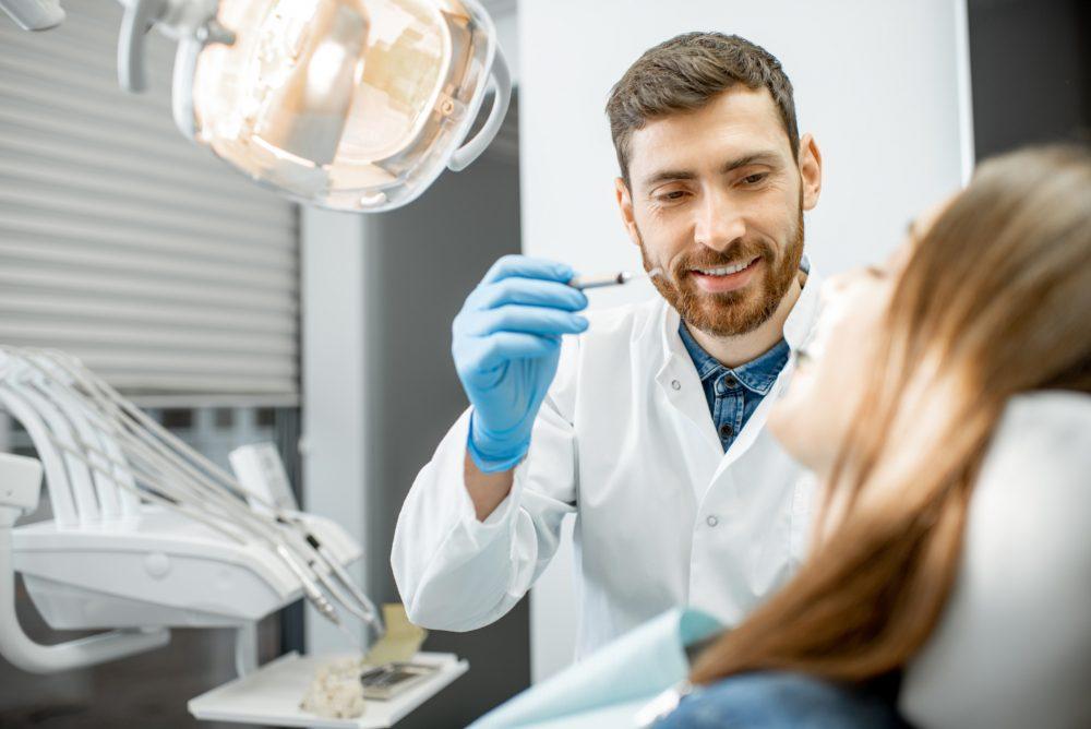 Dentist making dental examination