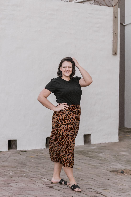 woman wearing a leopard print skirt