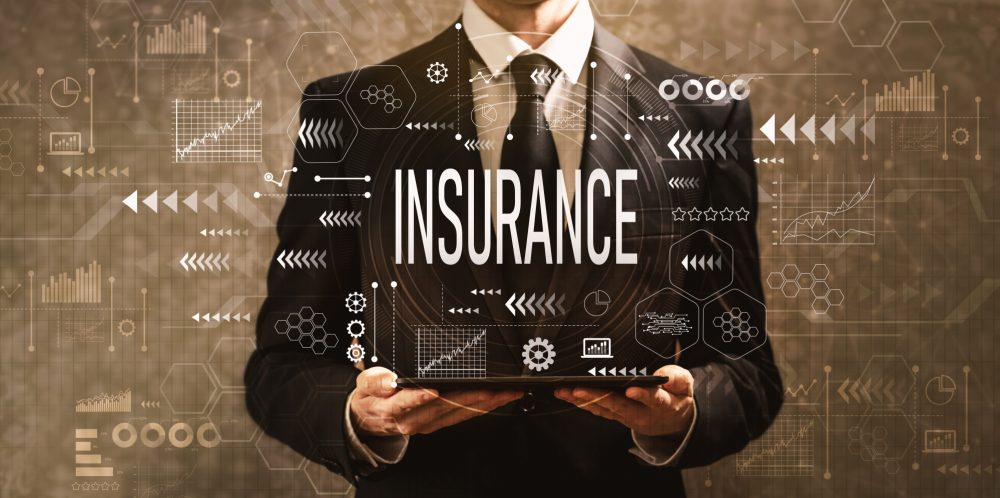 Insurance with businessman holding a tablet computer