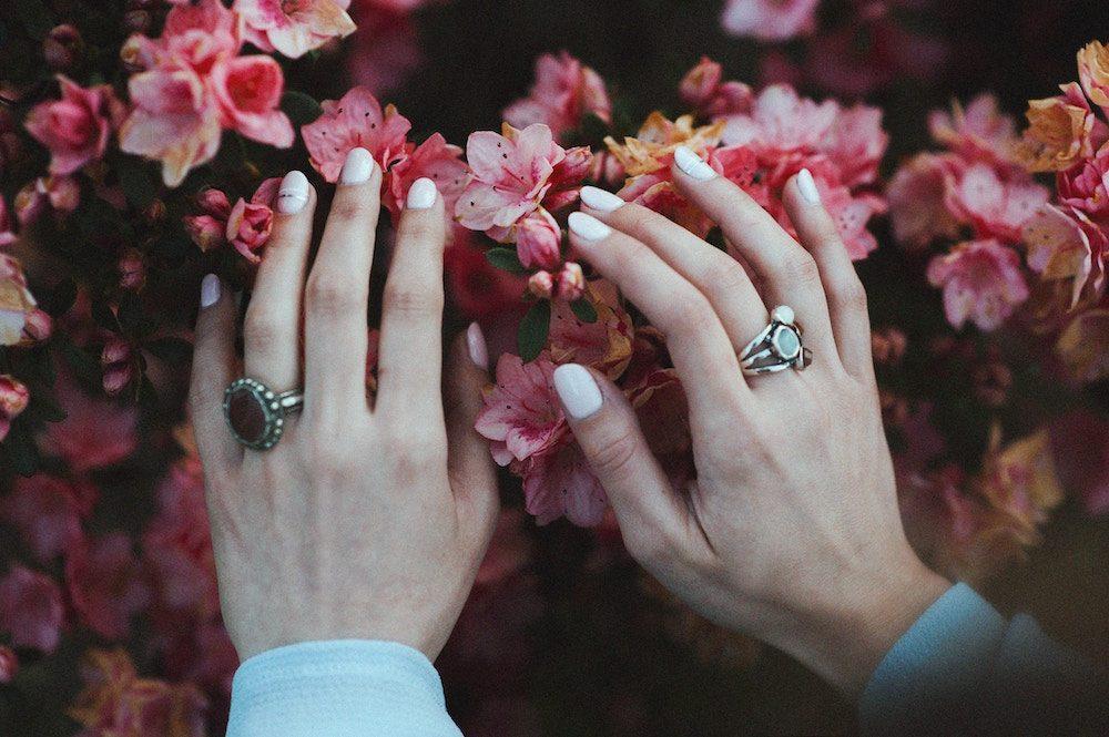 woman touching flowers