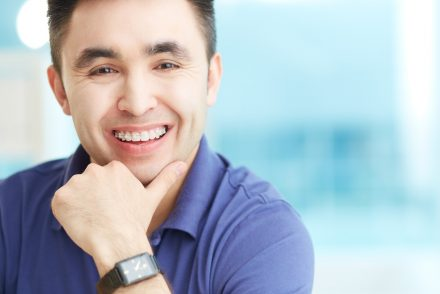 Smiling businessman with braces