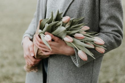 woman holding tulips