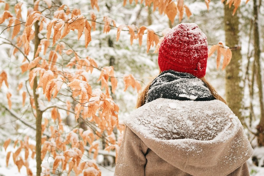 woman covered in a snow dusting