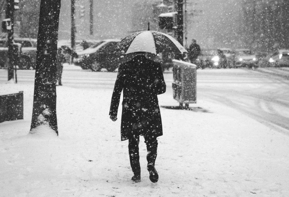 man walking in the snow