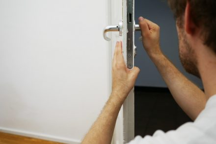 Man fixing lock of door