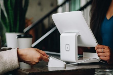 woman using square to pay