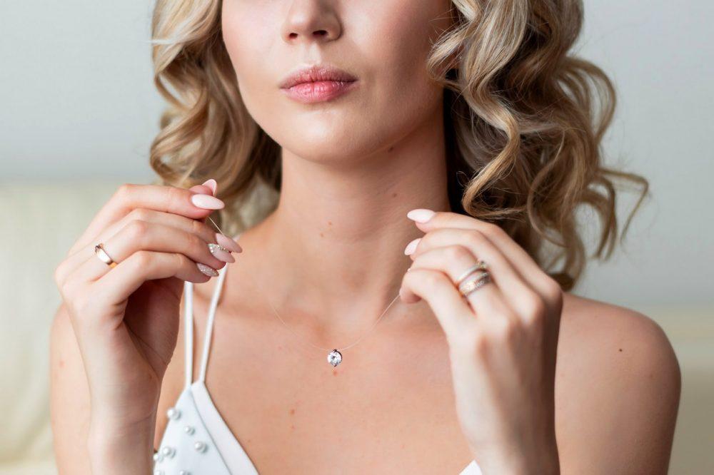 woman holding diamond necklace