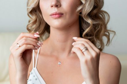 woman holding diamond necklace