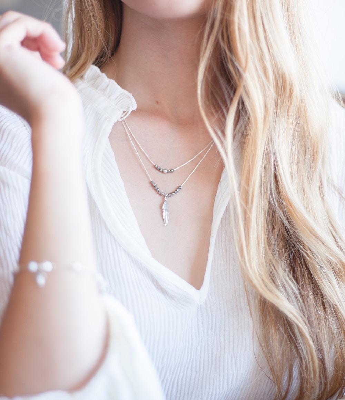 blonde woman wearing silver jewelry