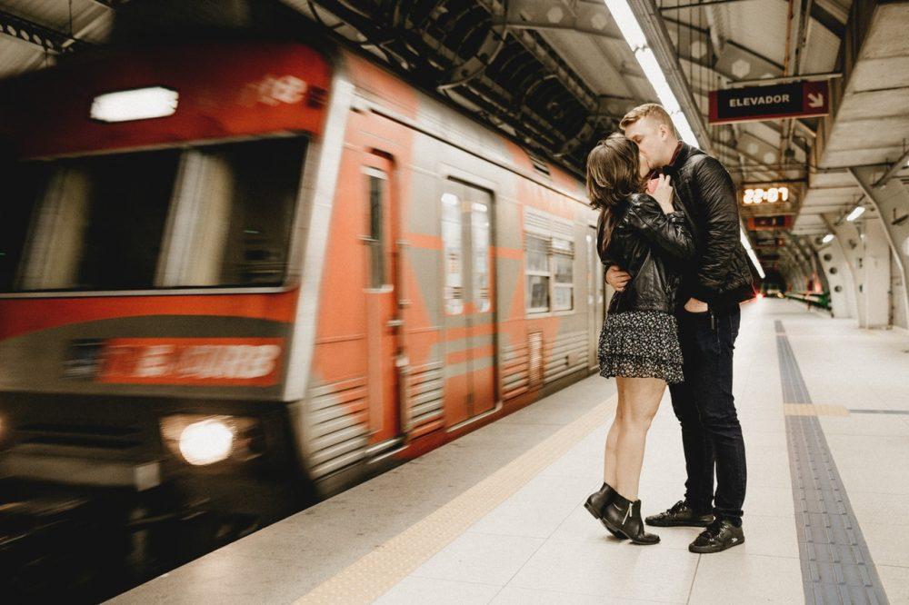 couple kissing on subway platform