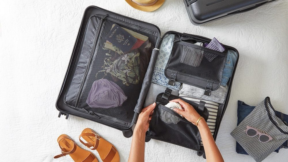 woman packing luggage