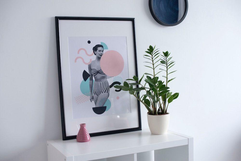 framed picture on shelf