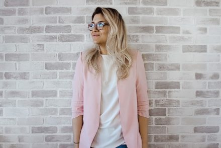 woman in pink blazer