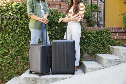 women holding brandless luggage