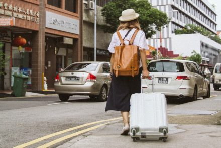woman pulling luggage