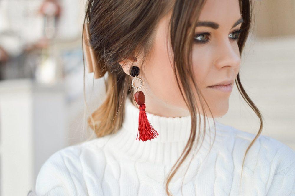 woman wearing statement earrings