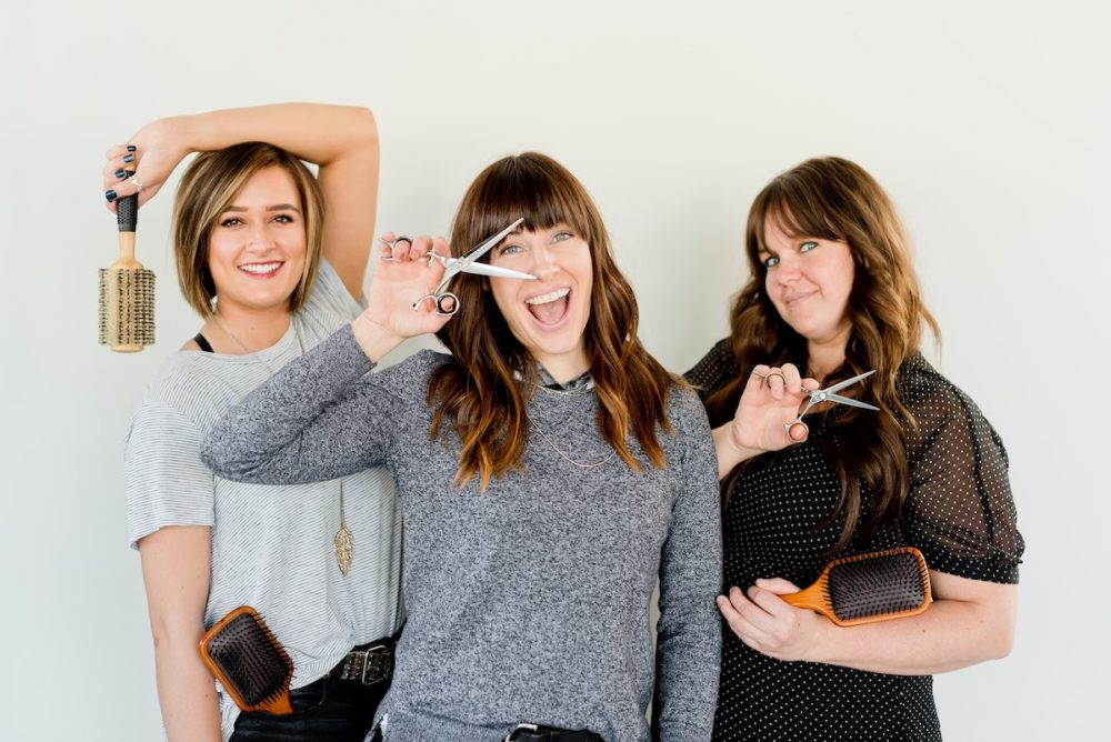 Three hairstylists
