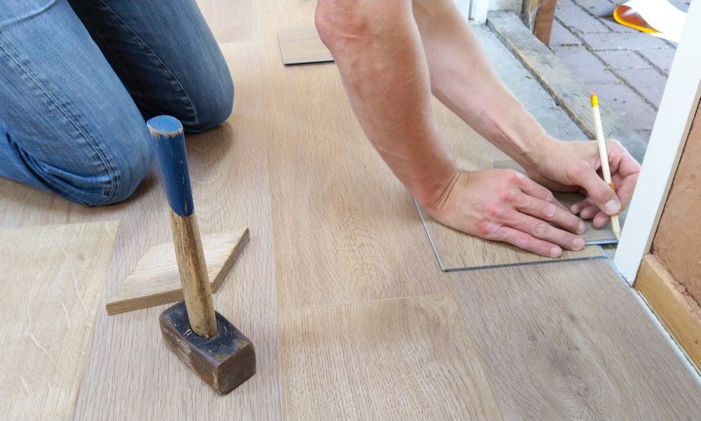 man putting in eco-friendly flooring
