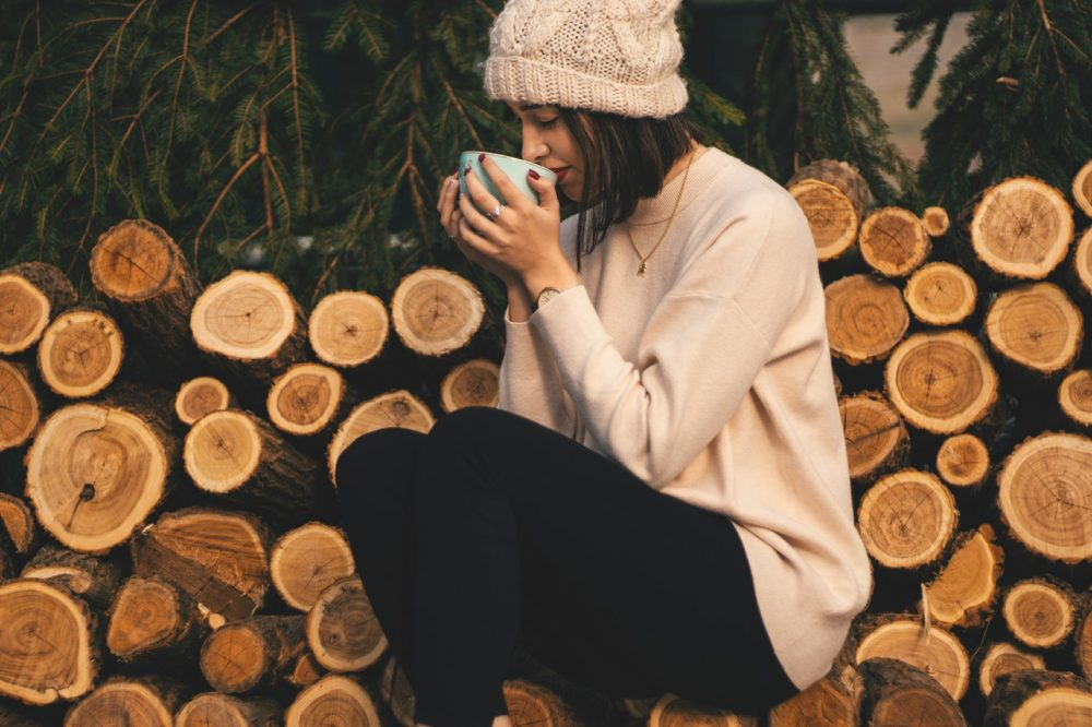 Woman drinking out of mug
