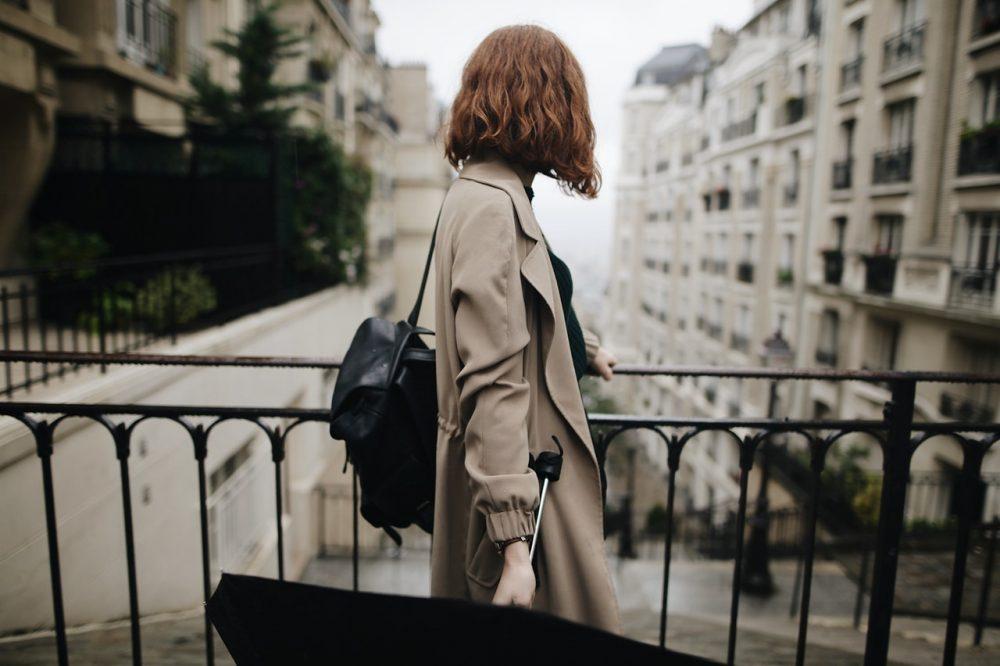 Woman on bridge looking away
