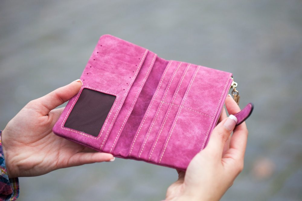 Woman opening an empty wallet