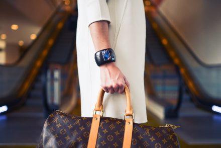Woman holding designer bag.