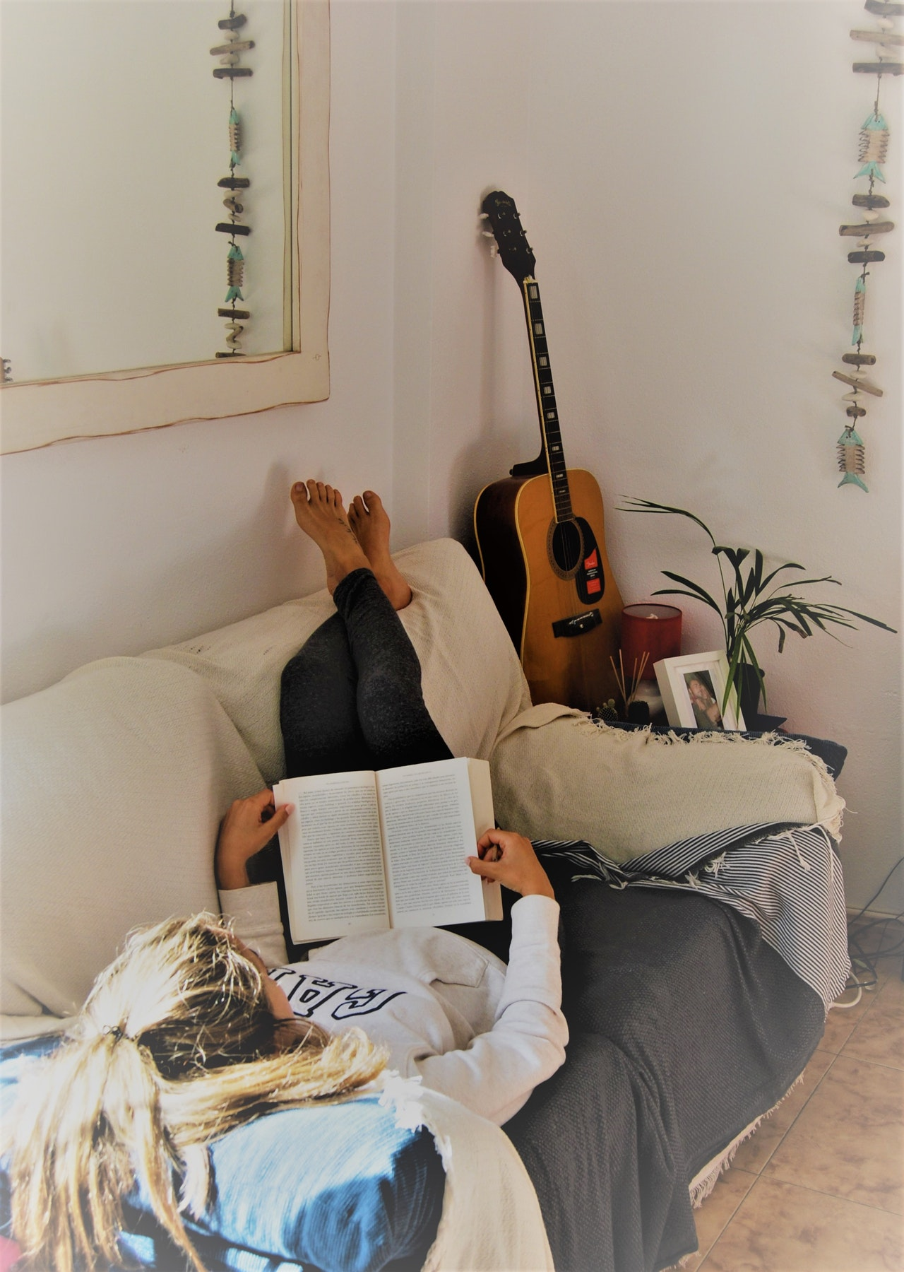 woman reading on cozy couch