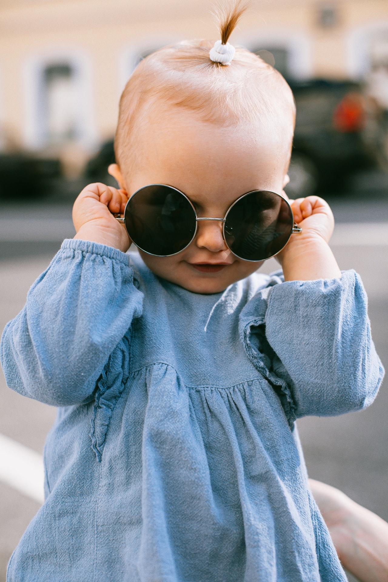 baby wearing round sunglasses