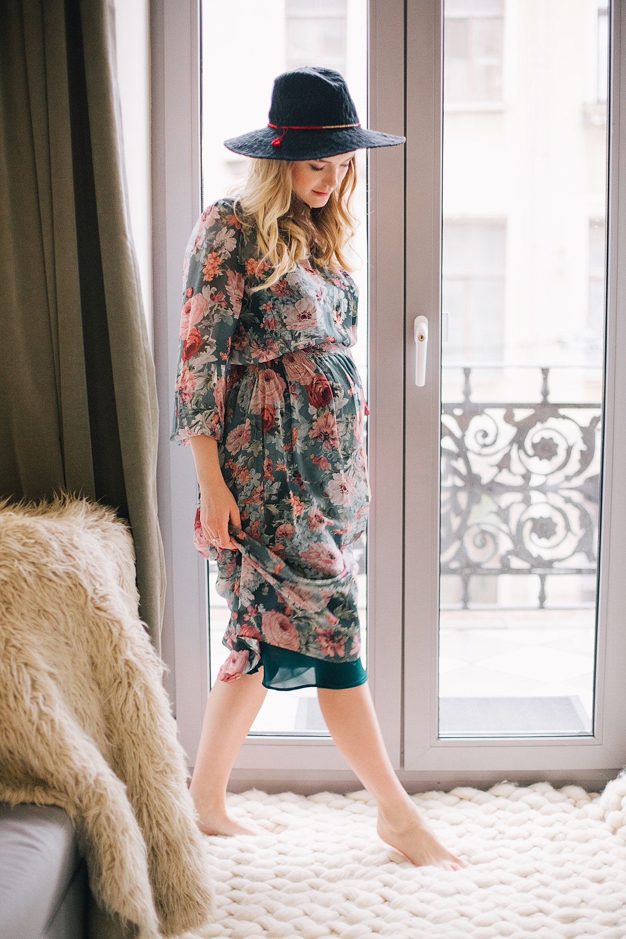 Woman in floral dress in bright room