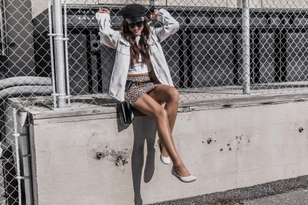 fashionable woman sitting outside
