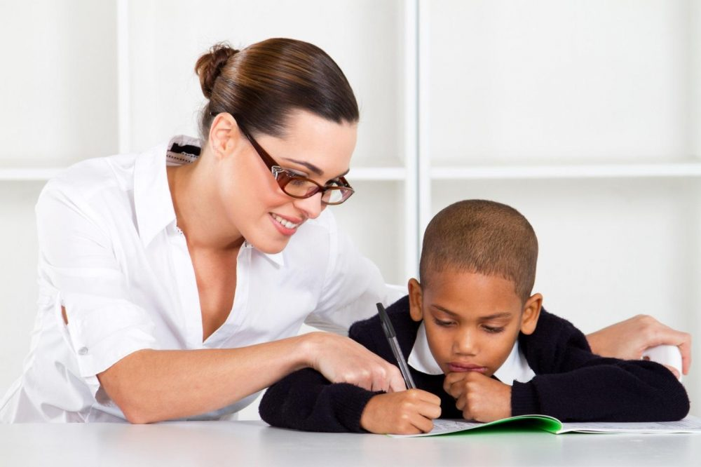 Woman tutoring child