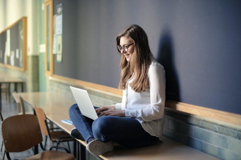 high school student sitting on desk