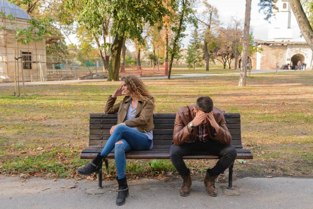 sad couple on bench