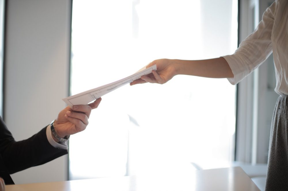 Woman handing over resume
