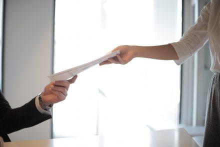 Woman handing over resume