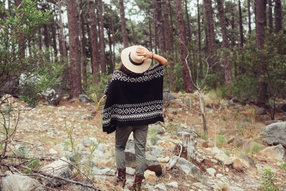 Woman in hat in the woods