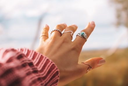 Woman's hand with gold and silver rings