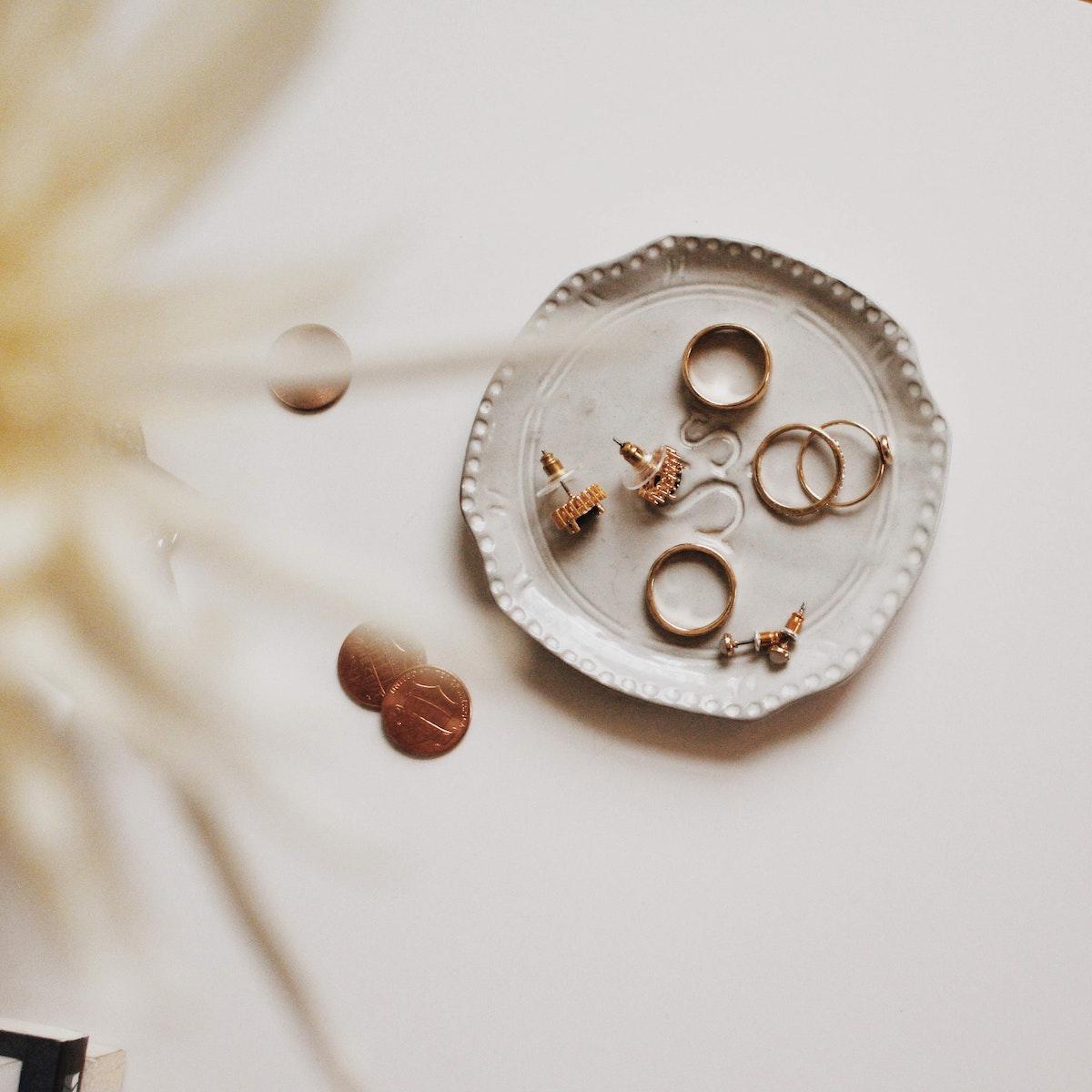 gold jewelry on a dresser