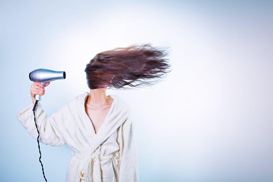 woman using a blowdryer