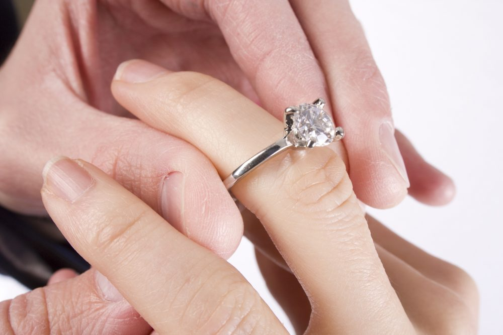 Sliding the engagement ring on