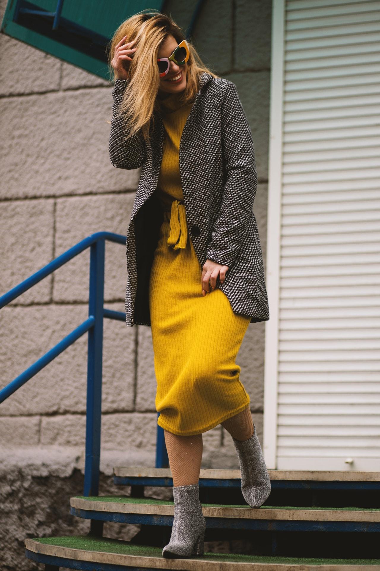 woman wearing a yellow knit dress