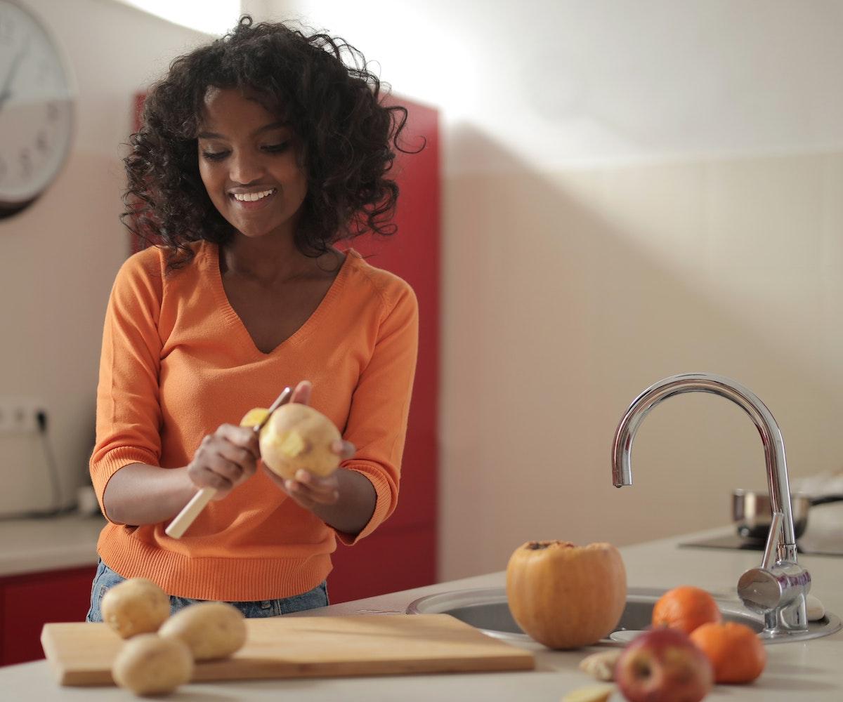 Woman peeling potato
