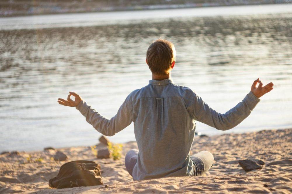 man sitting on a beach
