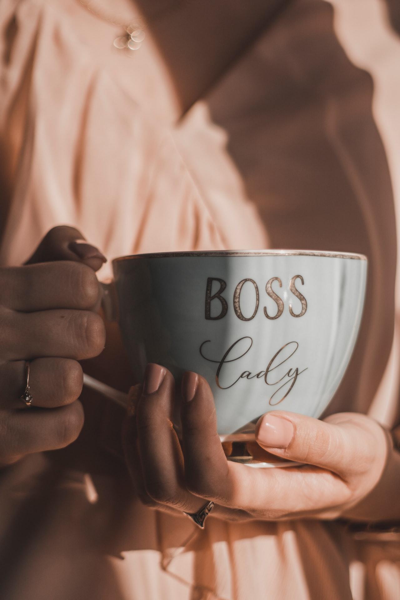 Woman holding a Boss Lady mug